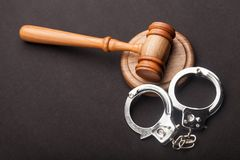 Gavel and handcuffs. Courtroom arbitrate attention auction bid black Royalty Free Stock Image
