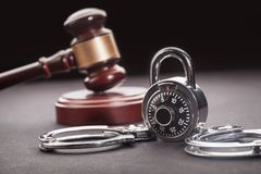 Gavel and handcuffs. Courtroom arbitrate attention auction bid black Stock Photos