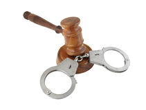 Gavel and handcuffs isolated Royalty Free Stock Photos