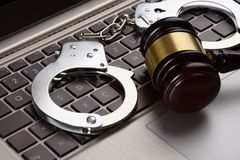Gavel and handcuffs on laptop Royalty Free Stock Photos