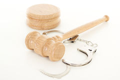Gavel with handcuffs Stock Photo