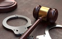 Gavel and handcuffs on wooden table background Royalty Free Stock Photo