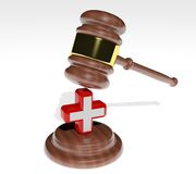 Gavel with health cross Stock Photography