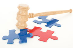 Gavel hitting colourful puzzle pieces Royalty Free Stock Photo