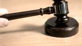 Gavel hitting in super slow motion a sound block Royalty Free Stock Photos