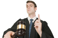The gavel of judge in foreground Royalty Free Stock Photo