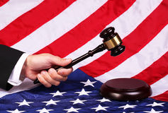 Gavel on Judge Hand over American Flag Royalty Free Stock Photo
