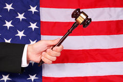 Gavel on Judge Hand over American Flag stock images