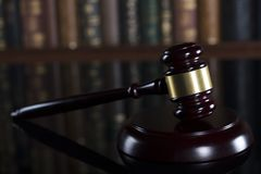 Law theme – court library. Gavel of the jugde in the court library Royalty Free Stock Photo