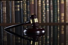 Law theme – court library. Gavel of the jugde in the court library Stock Image