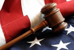 Gavel Of Justice. Wooden Gavel and American Flag Stock Photos