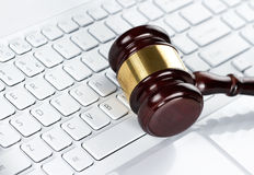 Gavel at the keyboard Stock Photo