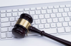 Gavel at the keyboard Royalty Free Stock Photo
