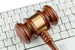 Gavel on keyboard Stock Photos