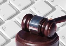 Gavel and keyboard. Digital composite of Gavel and keyboard Stock Photo