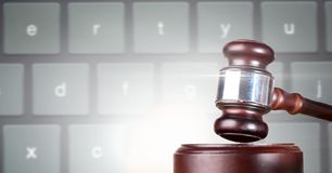Gavel and keyboard. Digital composite of Gavel and keyboard Royalty Free Stock Photo