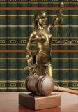 Gavel and Lady of Justice. Wooden gavel and Lady of Justice Stock Photos
