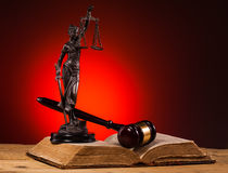 Gavel, lady of justice and old book. With red background Royalty Free Stock Photography