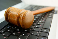 Gavel on a laptop computer Royalty Free Stock Photos