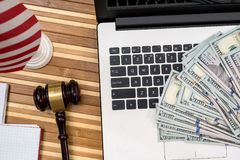 Gavel with laptop, dollar, notepad and flag.  Stock Photography