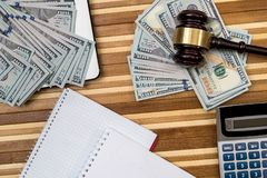 Gavel with laptop, dollar, notepad. And flag Stock Images