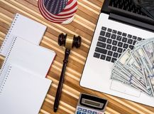 Gavel with laptop, dollar, notepad. And flag Royalty Free Stock Photos
