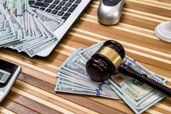 Gavel with laptop, dollar  notepad. Gavel with laptop, dollar, notepad and flag Stock Images