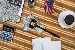 Gavel with laptop, dollar, notepad. And flag Royalty Free Stock Images