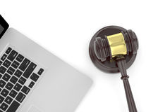 Gavel and laptop. On white Royalty Free Stock Photos
