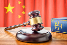 Gavel and a law book - China. A gavel and a law book - China royalty free stock photo