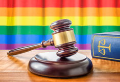 Gavel and a law book - Rainbow flag royalty free stock photography