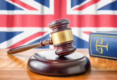 Gavel and a law book - United Kingdom Royalty Free Stock Photos