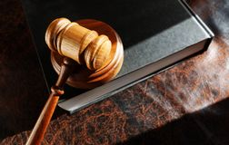 Gavel and lawbook. Judge's legal gavel on a law book Royalty Free Stock Images
