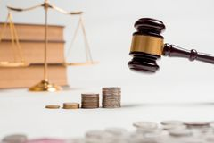 Gavel of lawyer with education book, house model and coin. Gavel of lawyer with education book, house model and coin for house tax or business investment Royalty Free Stock Images