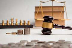 Gavel of lawyer with education book, house model and coin. Gavel of lawyer with education book, house model and coin for house tax or business investment Royalty Free Stock Photos