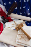 Gavel and legal documents arranged on American flag Royalty Free Stock Photography