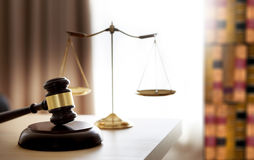 Gavel and legal Judge gavel scales of justice and law working on Royalty Free Stock Photos