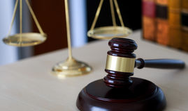 Gavel and legal Judge gavel scales of justice and law working on Stock Photography