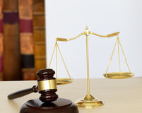 Gavel and legal Judge gavel scales of justice and law working on Royalty Free Stock Photography