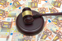 Gavel lying on the background of the euro Royalty Free Stock Image