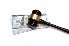 Gavel lying on a big stack of money  on white background Royalty Free Stock Photography