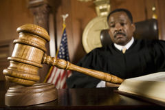 Gavel Lying In Front Of Judge Stock Image