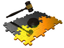 Gavel on metal puzzle. Royalty Free Stock Photography