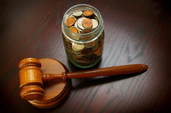 Gavel money. Legal gavel with coins in a jar Royalty Free Stock Photo