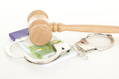 Gavel with money and handcuffs Stock Photos