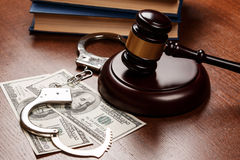 Gavel and money. On wooden table Stock Images