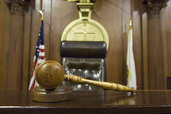 Gavel near judge's chair in court Royalty Free Stock Image