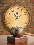 Gavel and old clock Stock Photography