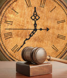 Gavel and old clock. Wooden gavel and old clock Stock Photos