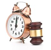 Gavel and old clock Royalty Free Stock Photos